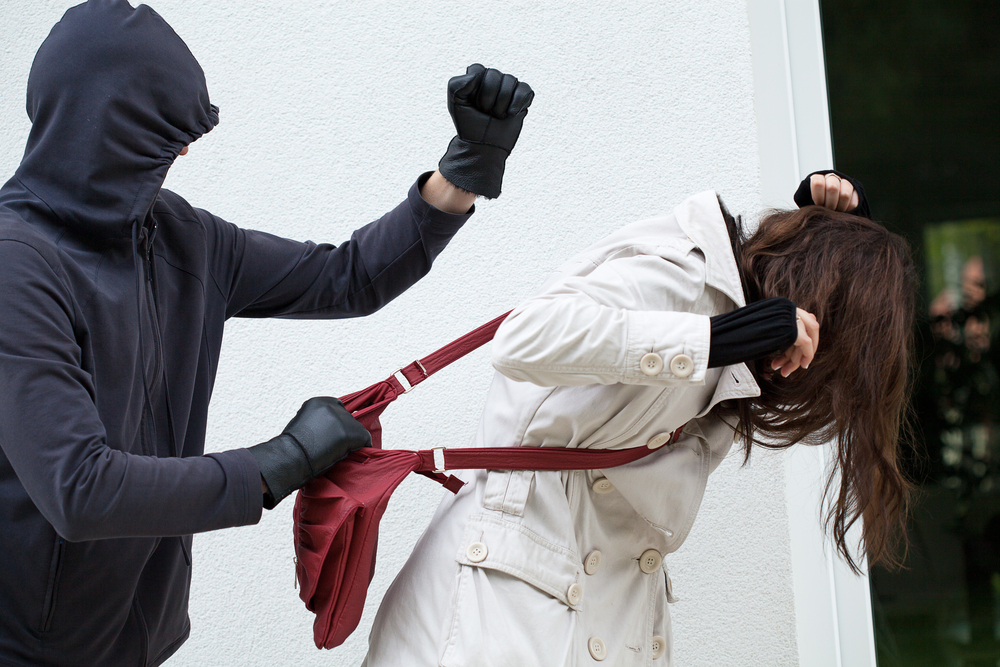 Masked man assaulting a woman