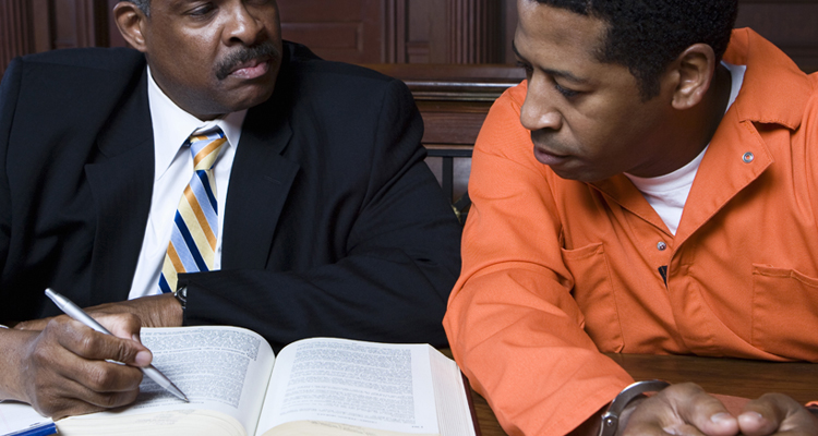 A lawyer helping his client with criminal law in Rancho Cucamonga, CA